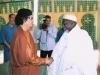 Shaykh Hassan Ali Cisse with Mu'amar Al-Qaddafi, Leader of Libya